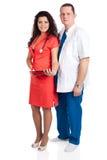 Glücklicher stattlicher Doktor und reizvolle Krankenschwester Stockbilder
