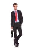Glücklicher und entspannter Geschäftsmann-Espritaktenkoffer Lizenzfreie Stockfotografie