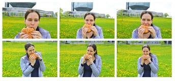 Glückliches Beautuful-Mädchen, das Hamburger isst. Satz 1. Lizenzfreie Stockfotografie