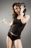 Glückliches DJ mit Kopfhörern Stockfotografie