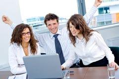 Glückliches erfolgreiches Geschäftsteam Lizenzfreie Stockfotos