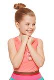 Glückliches frohes kleines Mädchen, das seitlich in der Aufregung, lokalisiert auf weißem Hintergrund schaut Stockfotos