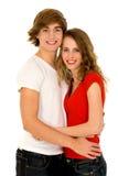 Glückliches junges Paarumarmen Stockbilder