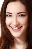Glückliches Lächeln des jugendlich Mädchenschönheits-Gesichtes Stockfoto
