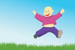 Glückliches Springen des kleinen Jungen Stockfoto