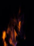 Gleam flame on  black background. Orange violet fire flames on  black background Stock Photo