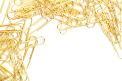 Gleaming golden paperclip Royalty Free Stock Photos