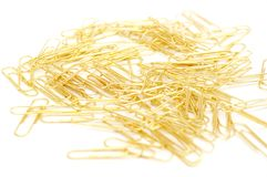 Gleaming golden paperclip Royalty Free Stock Images