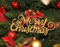Gleaming golden text Merry Christmas for decorating the house du. Ring Christmas time Stock Images