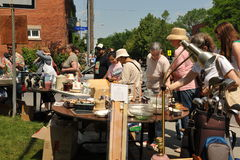 Glebe Garage Sale in Ottawa. Thousands of people gather at the annual Glebe neighborhood garage sale, a tradition in Ottawa. It takes place for several blocks in Royalty Free Stock Photos