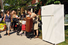Glebe Garage Sale in Ottawa. Thousands of people gather at the annual Glebe neighborhood garage sale, a tradition in Ottawa. It takes place for several blocks in Stock Photo