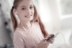 Gleeful cute girl listening to music royalty free stock photos