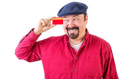 Gleeful man eyeing his credit card with a smile Royalty Free Stock Photography
