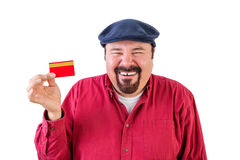 Gleeful man holding up a bank card Royalty Free Stock Images