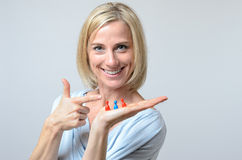 Gleeful woman pointing to three meeples Royalty Free Stock Image