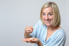 Gleeful woman pointing to triple six dice Stock Image