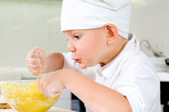 Gleeful young chef baking in the kitchen Stock Photos