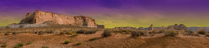 Glen Canyon Arizona Desert Purple Haze Sky. Arizona`s colorful purple sky over the desert plains and plateau of Glen Canyon royalty free stock image