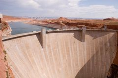 Glen Canyon Dam 2. Lake Powell backs up in the red sandstone canyons behind the Glen Canyon Dam - horizontal view Stock Photos