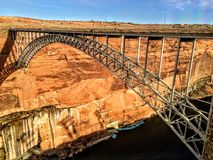 Glen Canyon Dam Bridge over the Colorado River. Sand stone walls traveling Royalty Free Stock Photo