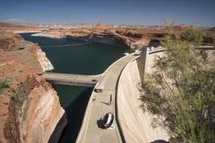 Glen Canyon Dam dam and Lake Powell from the Carl Hayden Visitor Centre. Page Arizona. Glen Canyon Dam is a concrete arch-gravity dam on the Colorado River in stock photo