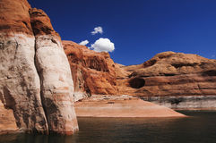 Glen Canyon and Lake Powell. Rugged boulders protrude out of Lake Powell near the Arizona/Utah border. Lake Powell is a boating enthusiasts dream in the desert Royalty Free Stock Photography