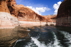 Glen Canyon and Lake Powell. Rugged boulders protrude out of Lake Powell near the Arizona/Utah border. Lake Powell is a boating enthusiasts dream in the desert Stock Images