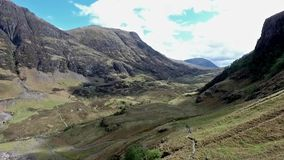 Glen Coe Highlands scotland aerial shot hiking and panorama view stock video footage