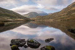 Glen croe scottish highlands. A long exposure of the glen croe mountains in the scottish highlands reflected in th loch Stock Photo
