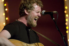 Glen Hansard. This is a picture of Glen Hansard, oscar winner, and from the band The Frames and Swell Season, who played a low key show at The Living Room, ( Stock Images