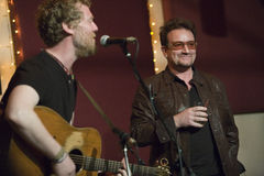 Glen Hansard and Bono. This is a picture of Glen Hansard, oscar winner, and from the band The Frames and Swell Season, who played a low key show at The Living Stock Photos