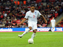 Glen Johnson strikes the ball Stock Photo