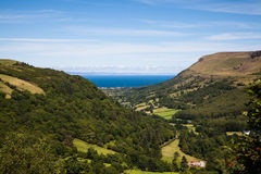 Glenariff in Summer. Glenariff in the Antrim glens with the Irish Sea and Scotland in the background stock image