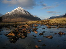 Glencoe. Snow capped moutain at the entrance of Glencoe, Highlands, Scotland Stock Images