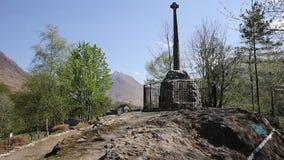 Glencoe monument in village in Glen Coe Lochaber Scottish Highlands Scotland UK in fine summer weather stock video