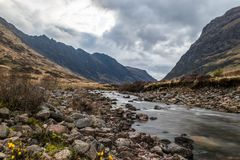 Glencoe river with smooth water flow. And cloudy day. hill views at the back, Rural Scene royalty free stock photos