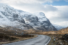 Glencoe road. Road into the valley of Glencoe (in the scottish highlands) with the mountain of Beinn Fhada on the left Stock Image