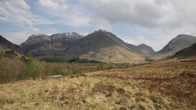 Glencoe Scotland UK stunning beautiful Scottish mountains famous tourist attraction pan view stock video