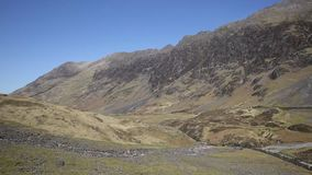 Glencoe Valley Scotland UK beautiful mountains and glen in sunny weather stock footage