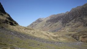 Glencoe Valley Scotland UK beautiful summer weather and mountains in sunshine stock footage