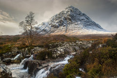 Glencoe in Winter. The mountain is Buachaille Etive Mor which rises above Rannoch Moor to a height of 1022m. It is located in  Glencoe in the Lochaber region of Stock Photography