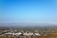 Glendale, Peoria and Phoenix, AZ. West side of Valley of the Sun looking at Glendale, Peoria and Phoenix as seen from North Mountain Park, Arizona. Copy space royalty free stock photo