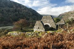 Glendalough Landscape with Trinity Church Ruin. Glendalough is a glacial valley in County Wicklow, Ireland, renowned for an Early Medieval monastic settlement Royalty Free Stock Image