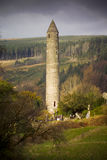 Glendalough. Round tower, built of mica-slate interspersed with granite is about 30 metres high, with an entrance 3.5 metres from the base Stock Photos