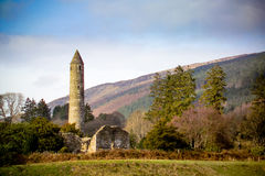 Glendalough. Round tower, built of mica-slate interspersed with granite is about 30 metres high, with an entrance 3.5 metres from the base Royalty Free Stock Image