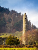 Glendalough. Round tower, built of mica-slate interspersed with granite is about 30 metres high, with an entrance 3.5 metres from the base Royalty Free Stock Images