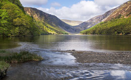Glendalough upper lake lit up by the sun, ireland. Continuing on the wicklow way i passed the upper lake once more. Beautiful royalty free stock photography