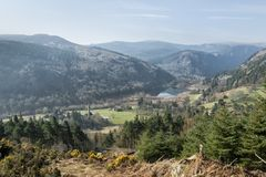 Glendalough Valley View. Landscape view over the valley of Glendalough and it`s round tower, County Wicklow, Ireland`s ancient east Stock Photography