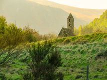Glendalough Valley, Wicklow Mountains National Park, Ireland. Ancient church in the Glendalough Valley, Wicklow Mountains National Park, Ireland Royalty Free Stock Photo