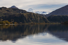 Glendhu Bay (Lake Wanaka) and Mount Aspiring. View of Lake Wanaka and Mount Aspiring on an Autumnal day. The only peak in New Zealand over 3000 metres outside of stock photo